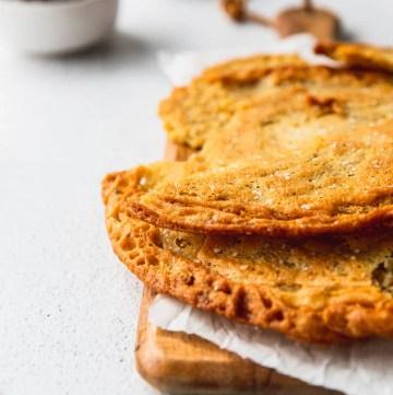 socca flatbread on wood serving tray