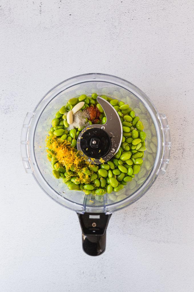 food processor with edamame hummus ingredients