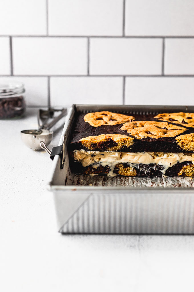 brookies in pan with cookie dough ice cream inside