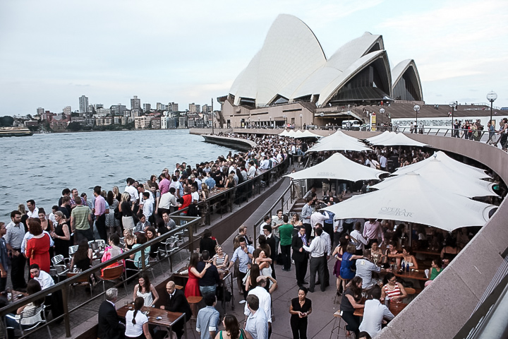 Happy hour outside the Sydney Opera House in Sydney, Australia, a great choice for budget traveling.