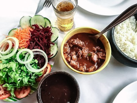 Brazilian feijoada, a great meal to share while budget traveling.