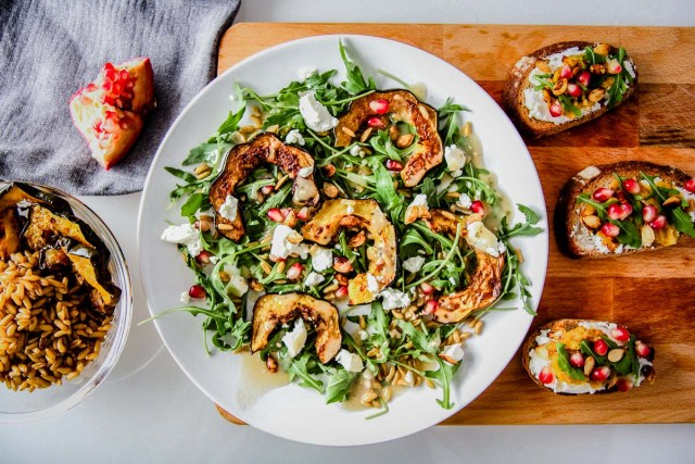 Winter Squash Salad with Pomegranates, Goat Cheese & Kamut, a fresh winter salad with arugula and winter vegetables and fruit that's perfect on toast. Who said winter produce was boring?
