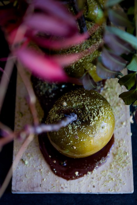 Pistachio Crusted Caramel Apples, candied apples dipped in caramel and dusted with crushed pistachios. A simple and delicious fall seasonal treat!