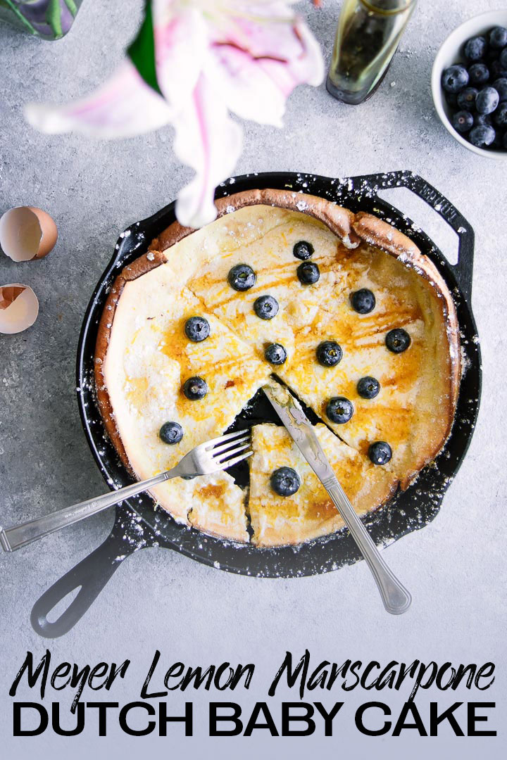 This dutch baby cake is perfect for weekend brunch! Baked until crispy and puffed on all side, it is topped with creamy marscarpone cheese, Meyer lemon zest, fresh berries, and then dusted with powdered sugar. The BEST easy pancake recipe for indulgent weekend breakfast. Delish! #dutchbaby #pancake #marscarpone #meyerlemon #breakfast #brunch