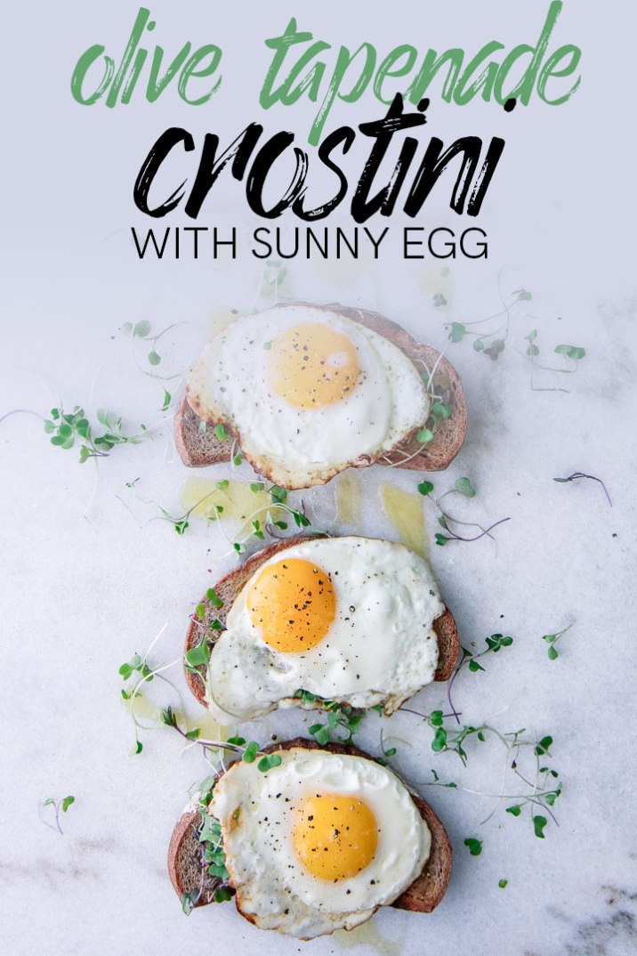 Olive Tapenade Crostini with Sunny Eggs, a simple yet delicious French breakfast of toast topped with olive and caper tapenade, microgreens, and a sunny and runny egg. Feel like you're in the South of France with this Mediterranean-inspired meal! #breakfast #tapenade #crostini #toast #french #sunnyegg #egg