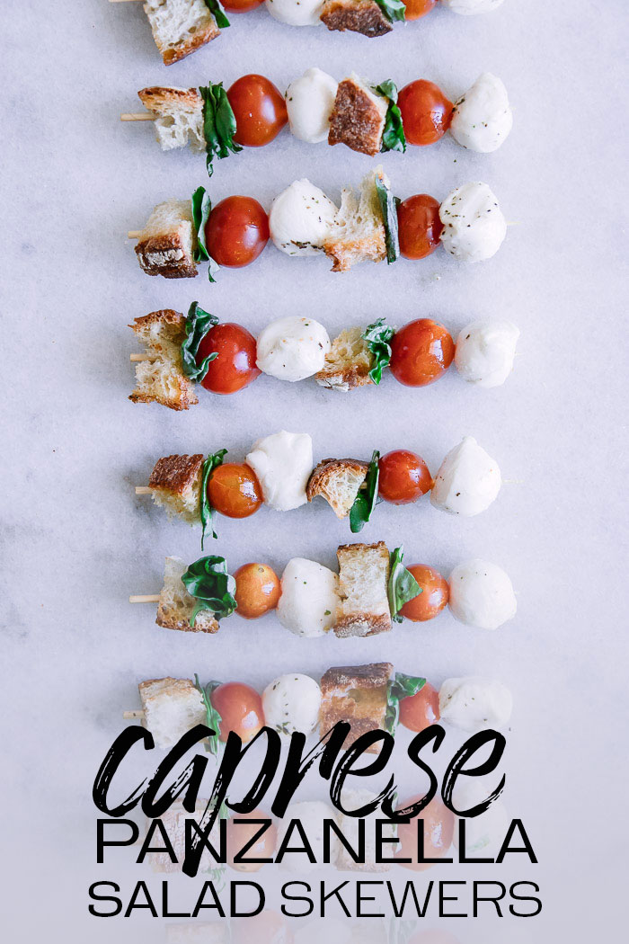 Caprese Panzanella Salad Skewers, a simple and fresh appetizer featuring cherry tomatoes, mozzarella, basil, and crusty bread on a skewer. Perfect for picnics and outdoor barbecues! #caprese #panzanella #salad #skewers #cherrytomatoes #basil #picnic #barbecue #cookout
