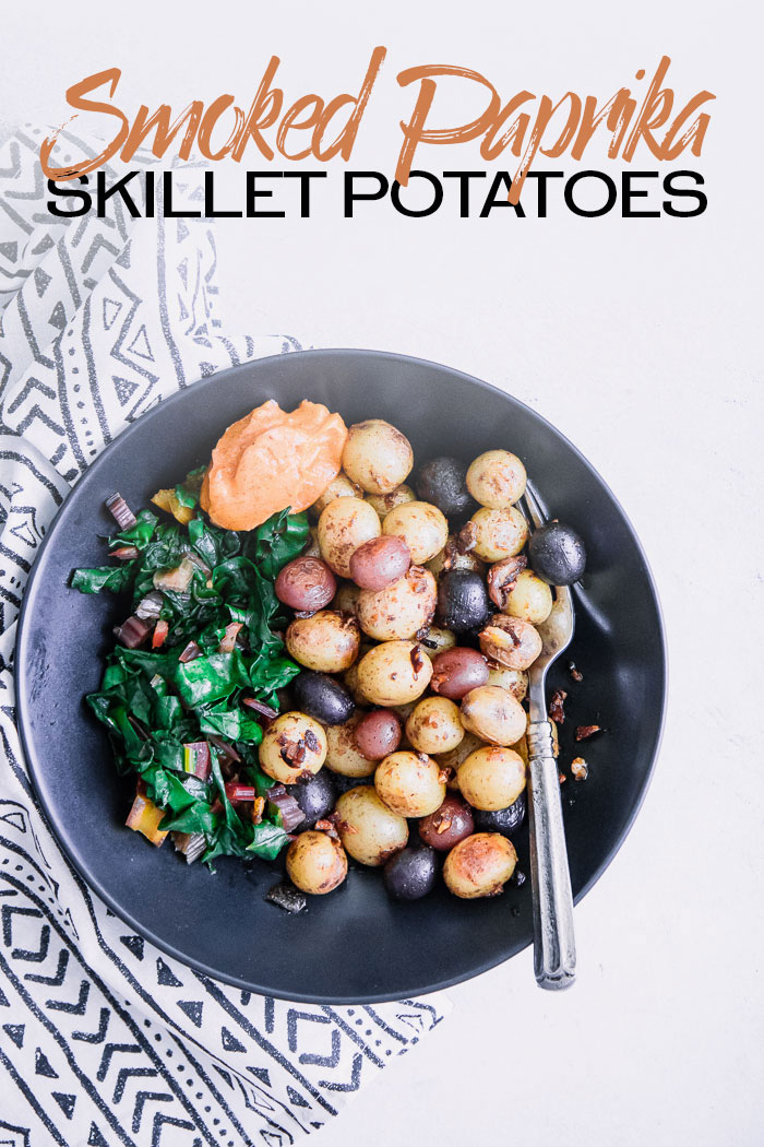 Smoked Paprika Skillet Potatoes, a simple vegan spuds recipe with pan fried new potatoes, garlic, paprika, and smoked salt crisped in a cast iron skillet. Perfect for breakfast, lunch, or dinner! #potatoes #paprika #smoked #salt #skillet #breakfast #brunch #easy
