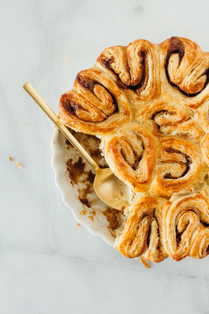 cinnamon croissant roll fork to belly