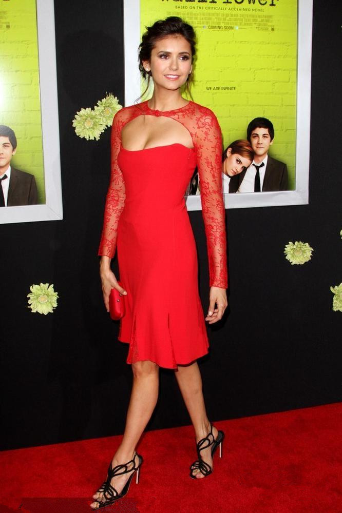Nina Dobrev's red knee length evening dress with lace sleeves