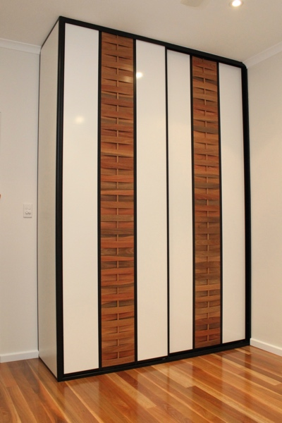 Built in Wardrobe with woven timber sliding doors