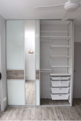 Wardrobe with Floating timber floorboards and elfa shelving