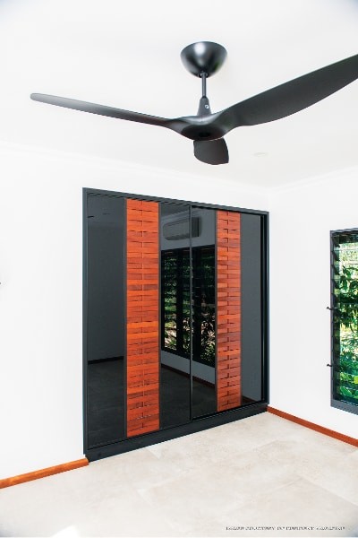 Built in Wardrobe Doors timber louvres and with Black Glass