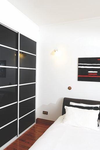 Multi Panel Wardrobe Sliding Doors with Black Glass & white frames
