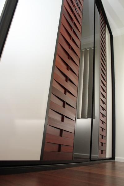 Timber Sliding Wardrobe Doors with Rock Salt Panels and black glass panels