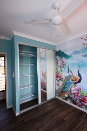 Children's Bedroom With Aqua Walls and sliding glass doors