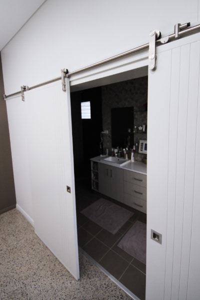 Barn Doors have been painted same colour as walls and are the entrance to the ensuite