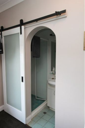 White Barn Doors showing arch opening and ensuite