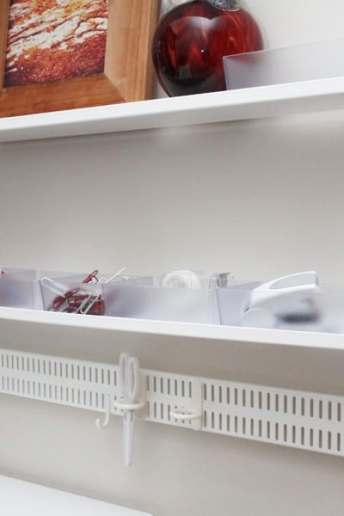 elfa home office pegboard and bucket shelves