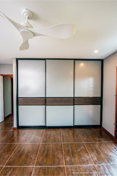 Built In Bedroom Wardrobe with crocodile wallpaper feature panel
