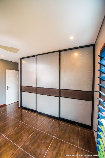 Cupboard Sliding Doors with Mesh panels and crocodile wallpaper