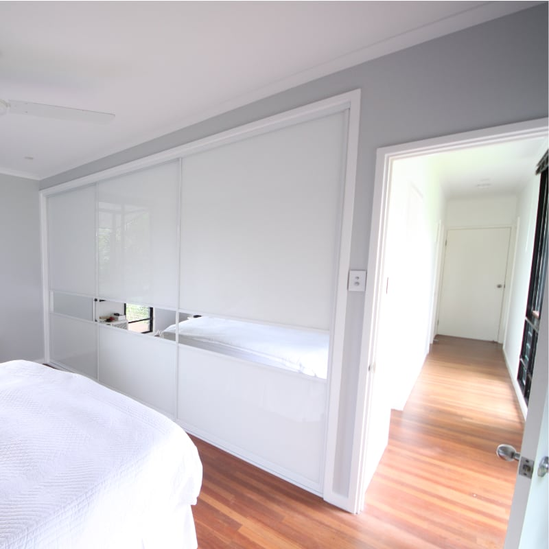 Built In White Glass Wardrobe with Feature Horizontal Mirror