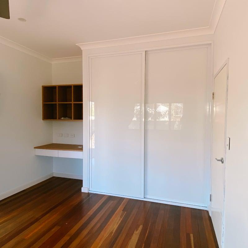 Shaker Style White Wardrobe Doors and Timber Floors