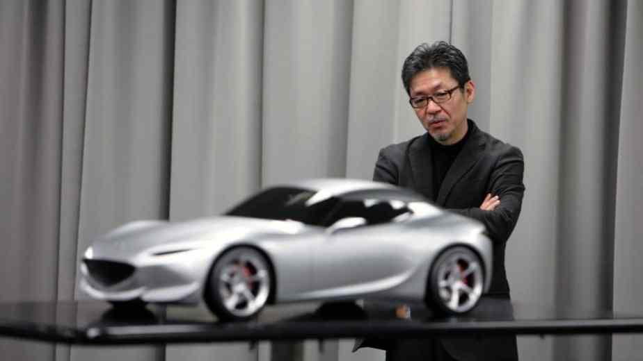 Mazda design boss Ikuo Maeda looks over a model of an alternative ND Mazda MX-5 proposal