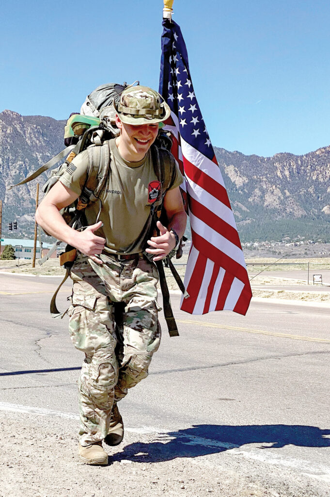 FORT CARSON, Colo. — Jacob Swords, cadet with 5th Mountain Ranger Battalion, carries the American flag along with a 35-pound rucksack April 10, 2021, during the Bataan Memorial Death March at Fort Carson, Colorado. The event was held to honor the victims of the original Bataan Death March, which occurred after the fall of the Philippines to Imperial Japan during World War II. (Photo by Staff Sgt. Daphney Black)