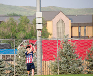 FORT CARSON, Colo. — A Soldier catches a fly ball to left field during intramural league play Aug. 3, 2021, at the Mountain Post Sports Complex. (Photo by Walt Johnson)