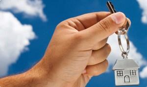 holding house key