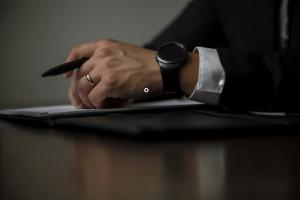 a person holding a black pen