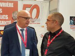 Entretien avec le président de FNSPF sur le stand de FO-SIS.