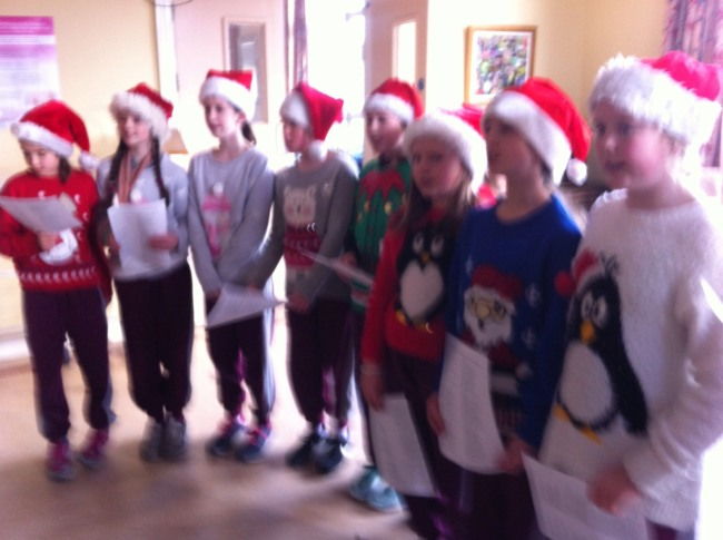 The choir sing and play music at the annual Station Mass at Ballydribeen Intellectual Disability unit. They also entertain residents at St. Columbanus' Nursing Home during the Christmas season, and this year the requests and participation by residents were uplifting.