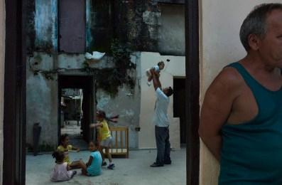 Kids playing inside their house. Regla, November, 2013.