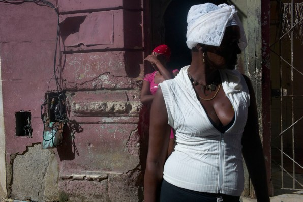 Ladies outside their house under the hot noon sun. Electrical cables are apparent everywhere in Habana. Habana Vieja, November, 2013.