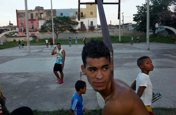 Young men playing soccer at the Ponton in Centro Habana. Ponton is a public sport complex in Havana where kids and adults come to exercise and play ball games. Usually kids come after school. November, 2013.