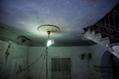 a crumbling ceiling and staircase in Old Havana