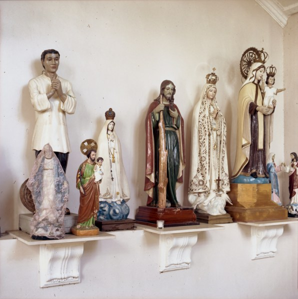 Religious relics are safely placed at the back of the Cathedral of the Transfiguration of Our Lord in Palo, along with a statue of San Lorenzo Luiz, a Filipino saint on the left. January 6, 2014