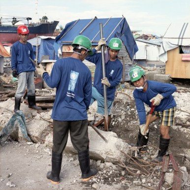 The locals were deployed by the United Nations Development Programme as part of the cash-for-work scheme. More than 200 of them are paid 260 pesos (5.8USD) daily to manually clear targeted zones of the worst affected communities. January 6, 2014.
