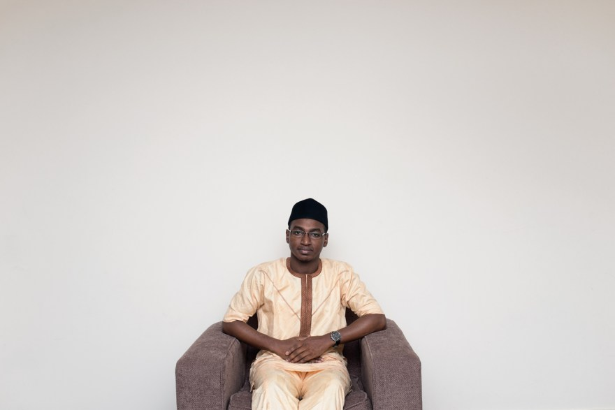 "Mohammed from Yobe State in Northern Nigeria, posing in his flat in Aberdeen, where he is living and doing his PhD in chemistry at the moment. While talking about Scotland, his experiences of living in Malaya, politics and religion he quote this sentence from Quran which I really like: ""(Show) kindness unto parents, and unto near kindred, and orphans, and the needy, and unto the neighbour who is of kin (unto you) and the neighbour who is not of kin (…)"""