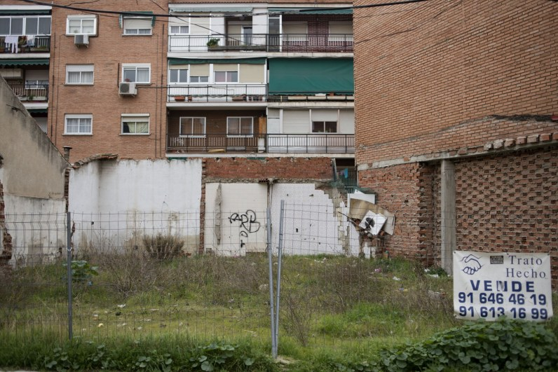 A crumbling piece of land stands for sale in Madrid. For sale signs can be seen all over Spain since the real estate bubble burst in 2008 forcing many people to sell their properties at a fraction of the price.