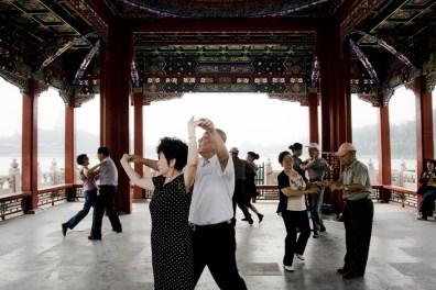 Beijing, People dance in Beihai Park.