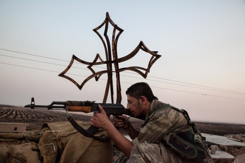 Only the cross remains on this church destroyed by IS fighters south of Tirbespiyeh.