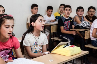 Syriac language summer school. The class sings the Syriac anthem at the start of morning lessons. Tirbespiyeh, Syria, June 2014