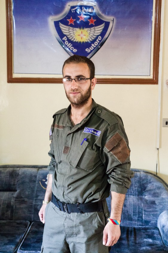 A member of the Sutoro in the militia's office in Tirbespiyeh