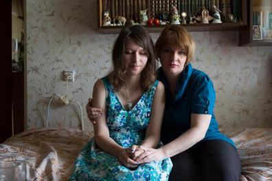 """Olga Yakimakha and her mother Olesia. From November 2013 she worked as a volunteer in Maidan. Her friend Ivan Tarsjuk was shot dead by a sniper on February 20. """"I spent several days and nights crying, and I still can't get over it. I'm hurting really bad."""""""