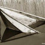 roeiboot in het water | Fotografie Arthur van Leeuwen