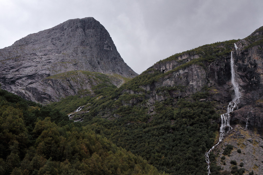 When the glacier melts, cascade thunder down the mountainsides in Briksdalen valley.