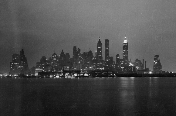 Lower Manhattan skyline at night, seen from either the Staten Island Ferry or Governor's Island, in February of 1938. (Bofinger, E. M.-Courtesy NYC Municipal Archives)