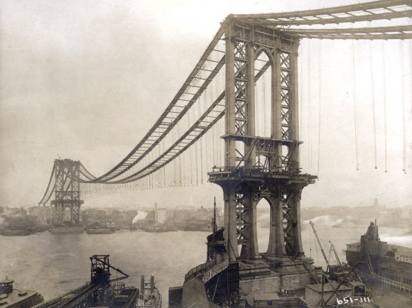 Manhattan Bridge, under-construction, seen from the roof of Robert Gair Building, showing suspenders and saddles, on February 11, 1909. (Eugene de Salignac-Courtesy NYC Municipal Archives)